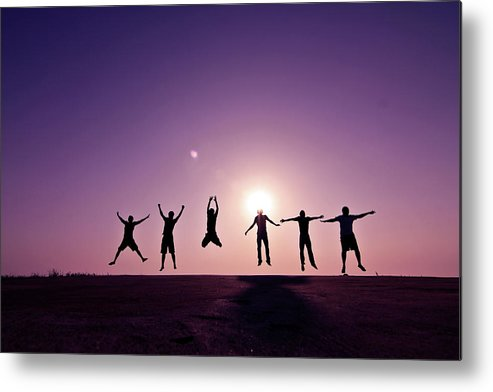 Human Arm Metal Print featuring the photograph Friends Jumping Against Sunset by Kazi Sudipto Photography