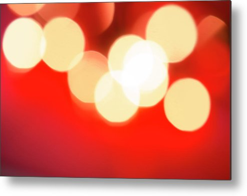 Christmas Lights Metal Print featuring the photograph Glowing Light On Red Background, Studio by Tetra Images