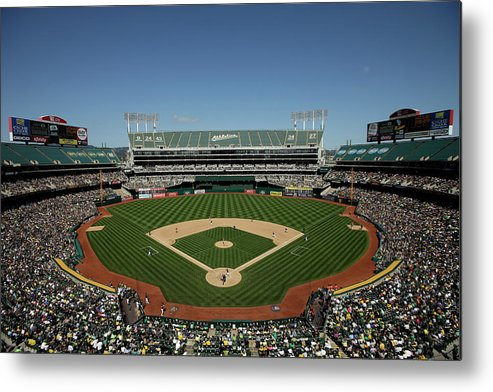 American League Baseball Metal Print featuring the photograph Houston Astros V Oakland Athletics by Ezra Shaw