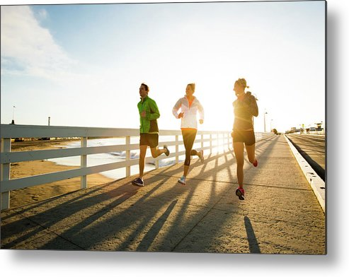 Young Men Metal Print featuring the photograph Jogging Along The Coast by Jordan Siemens