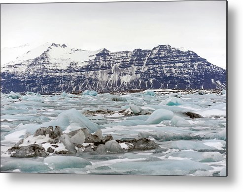 Tranquility Metal Print featuring the photograph Jokulsarlon by Photo By Dave Moore