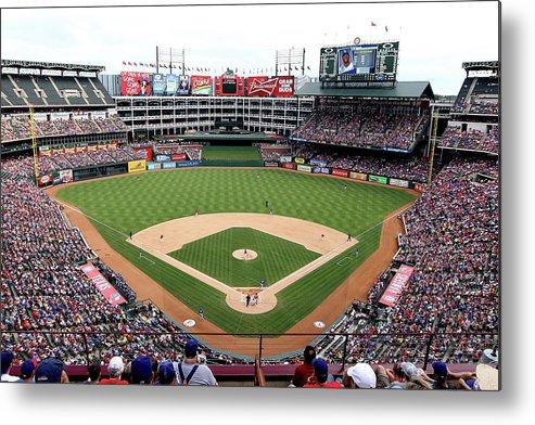 American League Baseball Metal Print featuring the photograph Kansas City Royals V Texas Rangers by Rick Yeatts