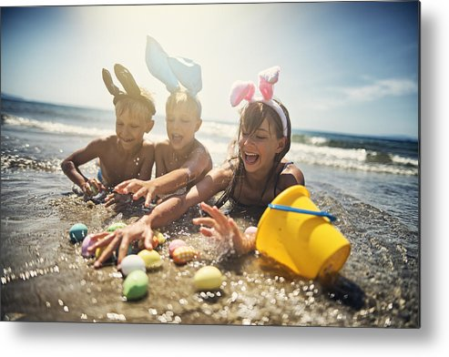 Easter Bunny Metal Print featuring the photograph Kids playing in sea during summer Easter by Imgorthand