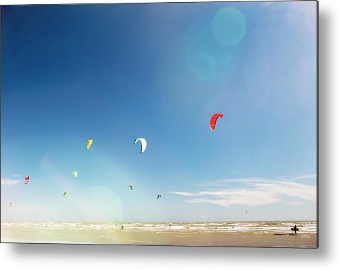 Water's Edge Metal Print featuring the photograph Kite Surfers by Nick David