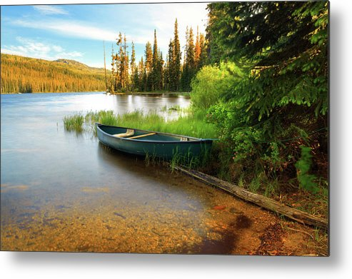 Tranquility Metal Print featuring the photograph Lone Canoe On Shores Of Upper Payette by Anna Gorin