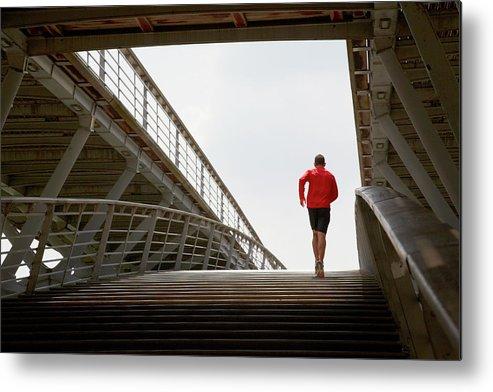 Steps Metal Print featuring the photograph Man Running Up A Bridge by Chris Tobin