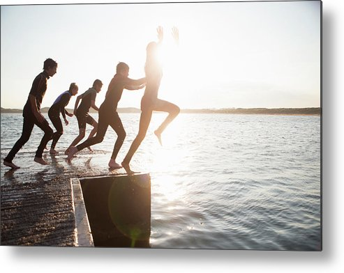 Adolescence Metal Print featuring the photograph Pier Jumping by Solstock