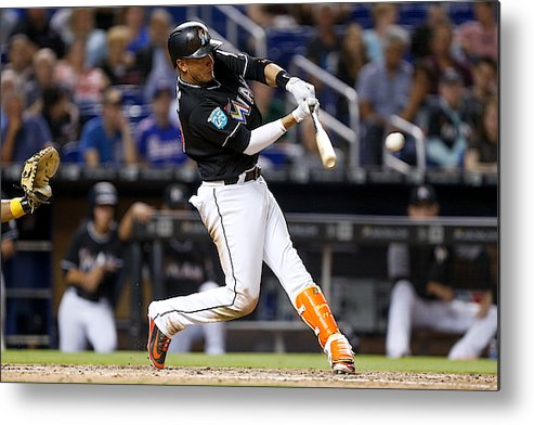 People Metal Print featuring the photograph Pittsburgh Pirates v Miami Marlins by Michael Reaves