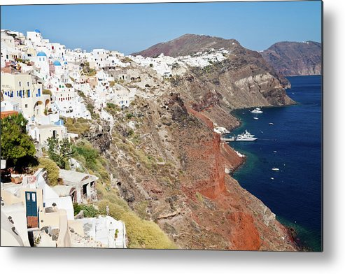 Tranquility Metal Print featuring the photograph Rows Of Houses Perch On Cliff In Oia by Melissa Tse