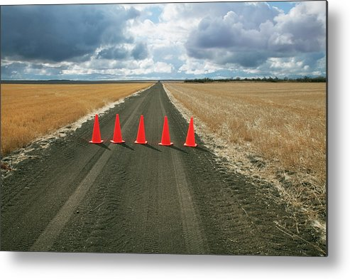 Orange Color Metal Print featuring the photograph Safety Cones Lined Up Across A Rural by Benjamin Rondel / Design Pics