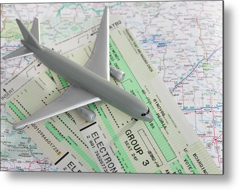 Airplane Metal Print featuring the photograph Studio Shot Of Toy Airplane With by Vstock Llc