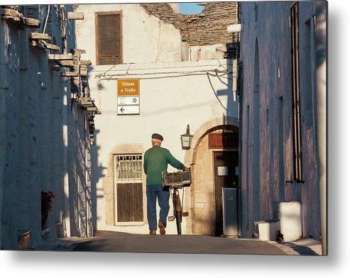 People Metal Print featuring the photograph Trulli Houses Alberobello Apulia Puglia by Peter Adams