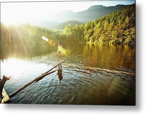 Pets Metal Print featuring the photograph Woman Walking On Log In Alpine Lake by Thomas Barwick