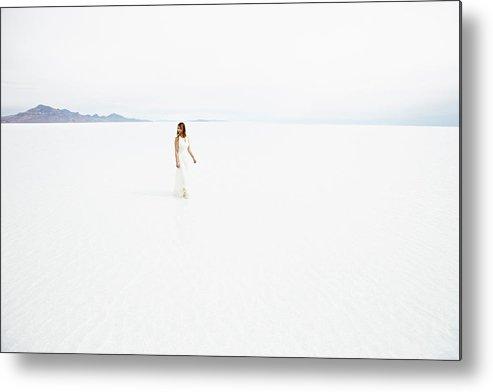 Scenics Metal Print featuring the photograph Woman Wearing Dress Walking Through by Thomas Barwick