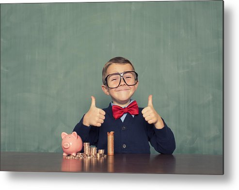 4-5 Years Metal Print featuring the photograph Young Boy Nerd Saves Money in His Piggy Bank by RichVintage