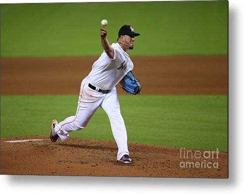 People Metal Print featuring the photograph Atlanta Braves V Miami Marlins by Rob Foldy