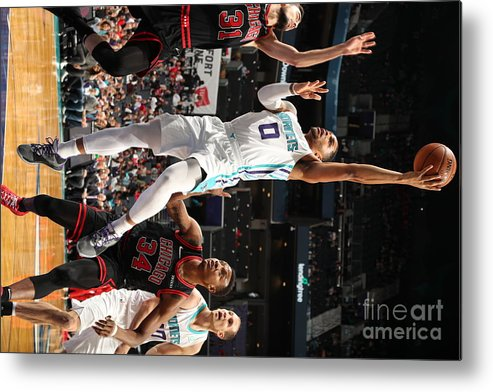 Chicago Bulls Metal Print featuring the photograph Chicago Bulls V Charlotte Hornets by Kent Smith