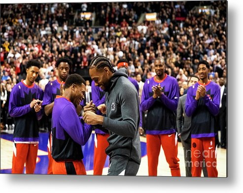 Nba Pro Basketball Metal Print featuring the photograph La Clippers V Toronto Raptors by Mark Blinch