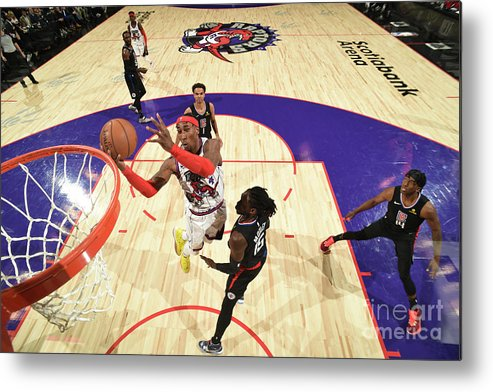 Nba Pro Basketball Metal Print featuring the photograph La Clippers V Toronto Raptors by Ron Turenne