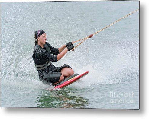 Kneeboarding Metal Print featuring the photograph Woman Kneeboarding by Microgen Images/science Photo Library