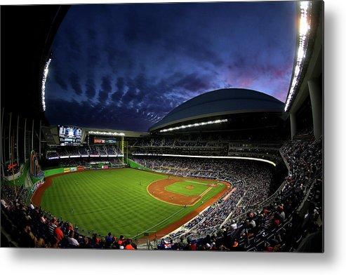 American League Baseball Metal Print featuring the photograph Colorado Rockies V Miami Marlins by Mike Ehrmann