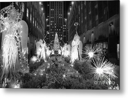 Holiday Metal Print featuring the photograph Christmas Tree At Rockefeller Center by Bettmann