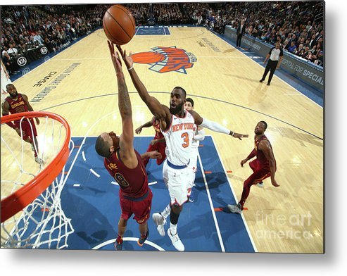 Tim Hardaway Jr. Metal Print featuring the photograph Cleveland Cavaliers V New York Knicks by Nathaniel S. Butler