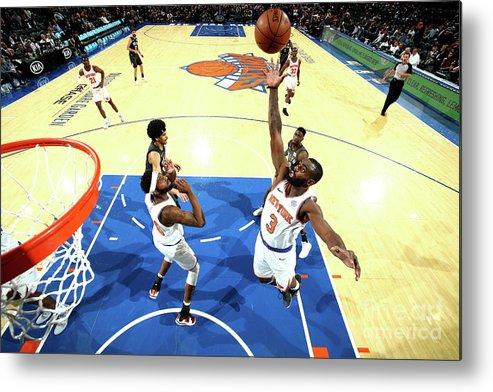 Tim Hardaway Jr. Metal Print featuring the photograph Brooklyn Nets V New York Knicks by Nathaniel S. Butler