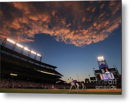 National League Baseball Metal Print featuring the photograph Philadelphia Phillies V Colorado Rockies by Doug Pensinger