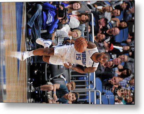 Nba Pro Basketball Metal Print featuring the photograph Brooklyn Nets V Orlando Magic by Gary Bassing