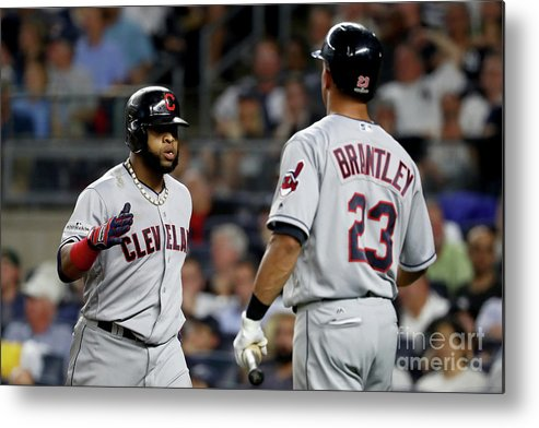 Three Quarter Length Metal Print featuring the photograph Divisional Round - Cleveland Indians V by Al Bello