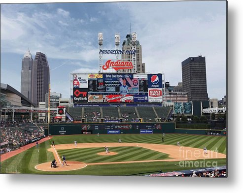 American League Baseball Metal Print featuring the photograph Texas Rangers V Cleveland Indians by Joe Robbins