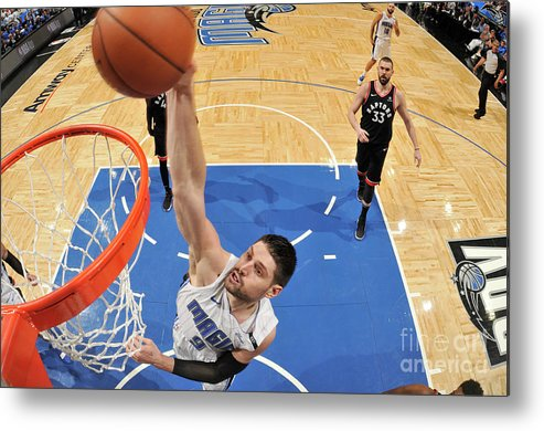Playoffs Metal Print featuring the photograph Toronto Raptors V Orlando Magic - Game by Fernando Medina