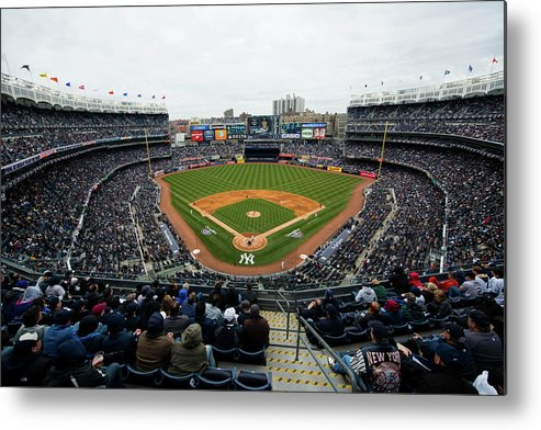 East Metal Print featuring the photograph Baltimore Orioles V. New York Yankees by Rob Tringali