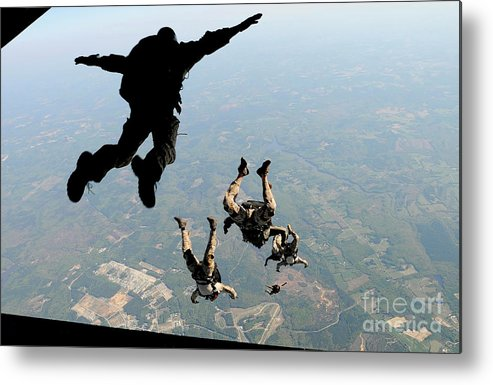 People Metal Print featuring the photograph Navy Seals Jump From The Ramp Of A C-17 by Stocktrek Images