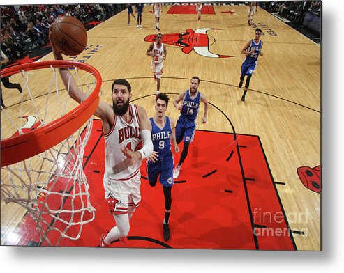 Nba Pro Basketball Metal Print featuring the photograph Philadelphia 76ers V Chicago Bulls by Gary Dineen