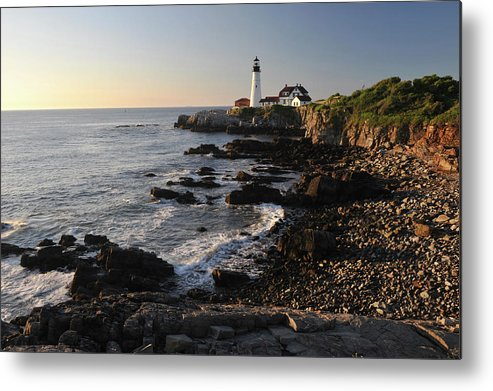 Water's Edge Metal Print featuring the photograph Portland Head Light by Aimintang