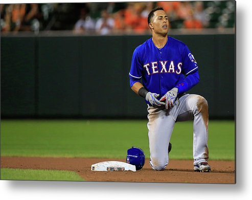 American League Baseball Metal Print featuring the photograph Texas Rangers V Baltimore Orioles by Rob Carr