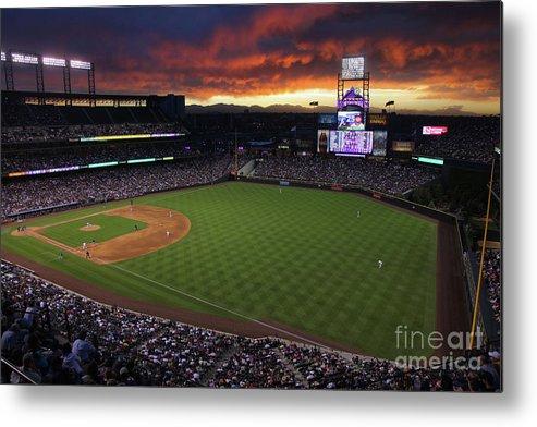 National League Baseball Metal Print featuring the photograph Atlanta Braves V Colorado Rockies by Doug Pensinger
