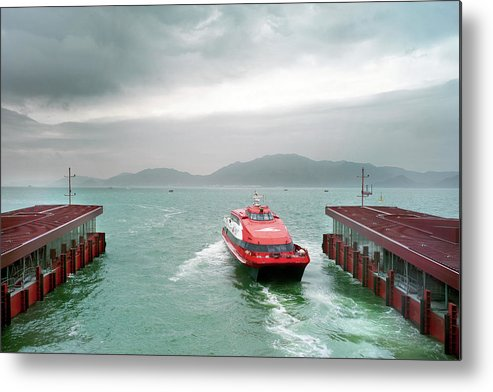Macao Metal Print featuring the photograph A Catamaran Ferry Docks At A Port by Xpacifica