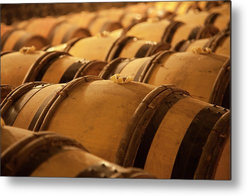 Fermenting Metal Print featuring the photograph An Old Wine Cellar Full Of Barrels by Brasil2