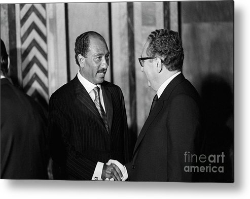 Mature Adult Metal Print featuring the photograph Anwar Sadat And Henry Kissinger by Bettmann