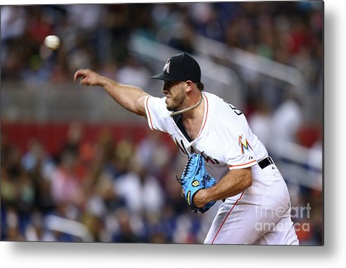 Three Quarter Length Metal Print featuring the photograph Atlanta Braves V Miami Marlins by Rob Foldy
