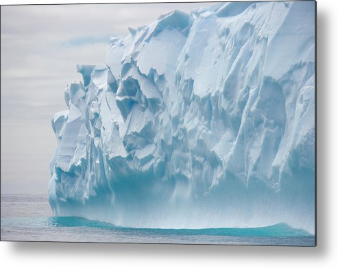 Scenics Metal Print featuring the photograph Blue Iceberg Carved By Waves Floats In by Eastcott Momatiuk