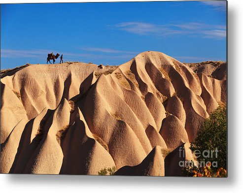 Kapadokya Metal Print featuring the photograph Camel And The Cameleer On The Rock by Yavuz Sariyildiz