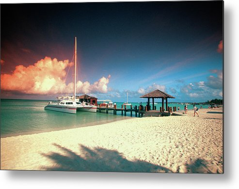 Sailboat Metal Print featuring the photograph Catamaran Docked At Pier At Sunset On by Medioimages/photodisc