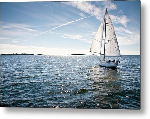 Recreational Pursuit Metal Print featuring the photograph Classic Yacht Sailing Away Against Blue by Jaap-willem