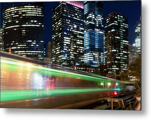 Passenger Train Metal Print featuring the photograph Commuter Train In Downtown Chicago by Chrisp0