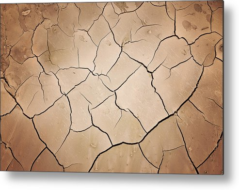Empty Metal Print featuring the photograph Cracks In Dry Earth by Kertlis