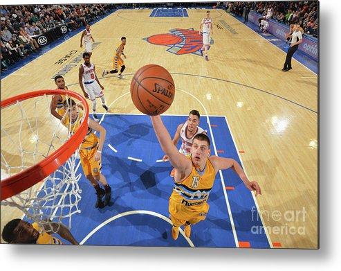 Nba Pro Basketball Metal Print featuring the photograph Denver Nuggets V New York Knicks by Jesse D. Garrabrant